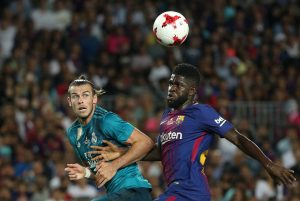 Barcelona's Samuel Umtiti in action with Real Madrid's Gareth Bale.