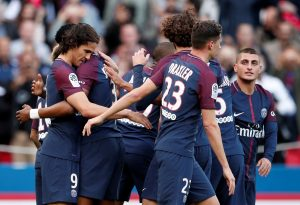Paris Saint-Germain's Edinson Cavani celebrates scoring their second goal with team mates.