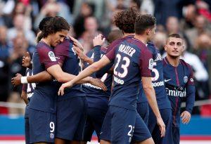 Paris Saint-Germain's Edinson Cavani celebrates scoring their second goal with team mates.