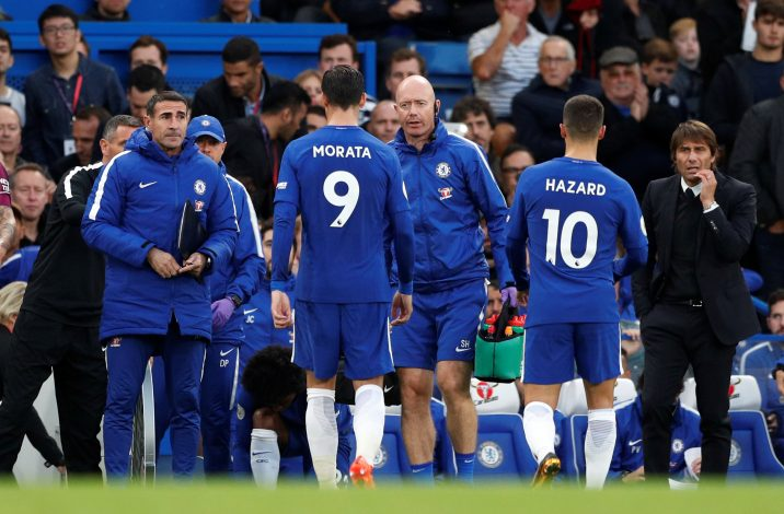 Chelsea's Alvaro Morata goes off injured.