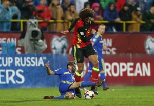 Bosnia's Senad Lulic in action with Belgium's Marouane Fellaini.