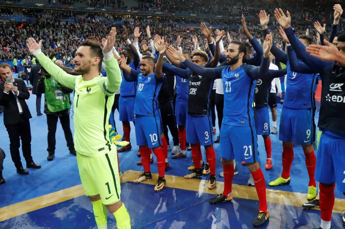 France's Hugo Lloris and team mates celebrate their qualification for the World Cup.