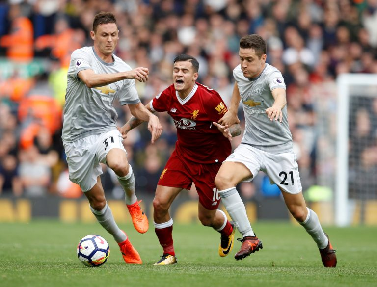 Philippe Coutinho in action with Nemanja Matic and Ander Herrera.