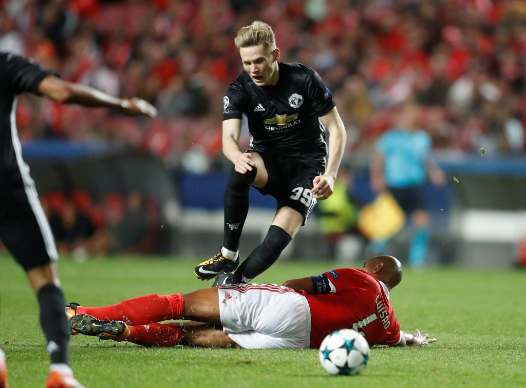 Benfica's Luisao fouls Manchester United's Scott McTominay leading to a second yellow card and red card.