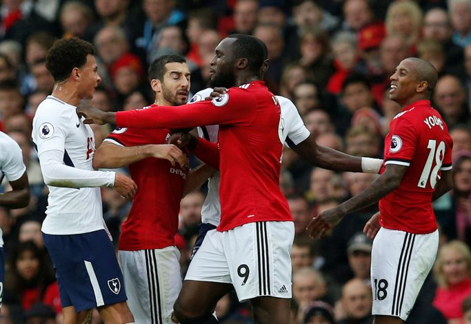 Romelu Lukaku and Ashley Young clash with Tottenham's Dele Alli.