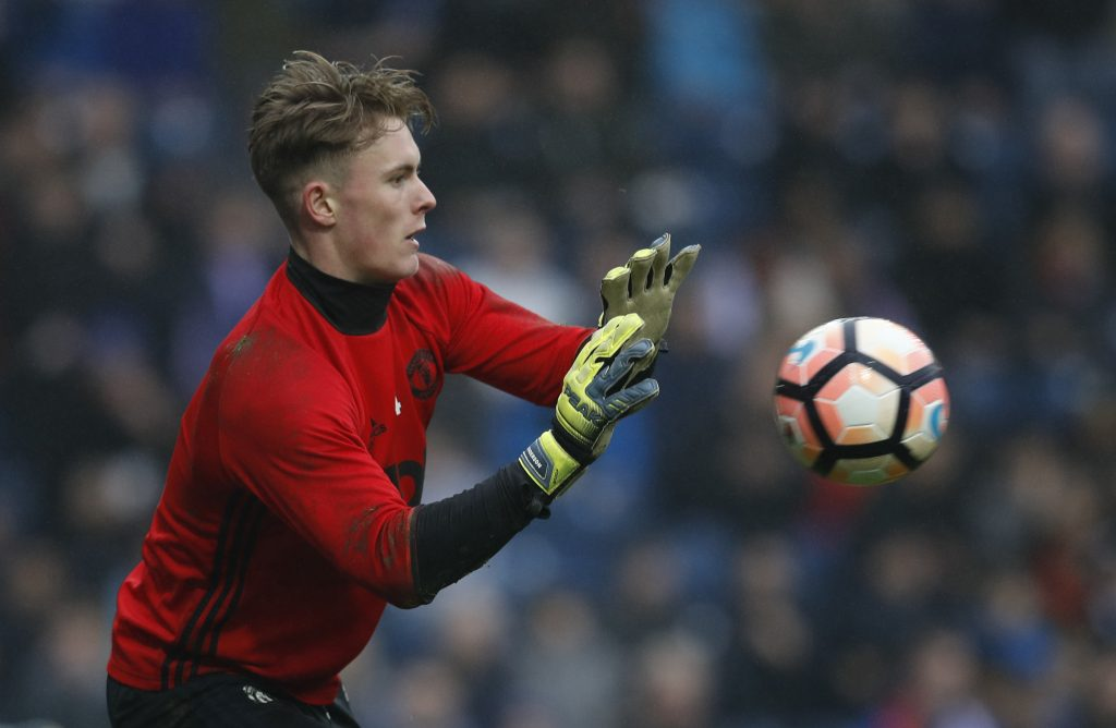 Dean Henderson warms up before the match.