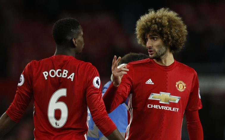 Manchester United's Paul Pogba and Marouane Fellaini celebrates after the game.