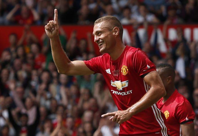 Manchester United '08 XI's Nemanja Vidic celebrates scoring their first goal.