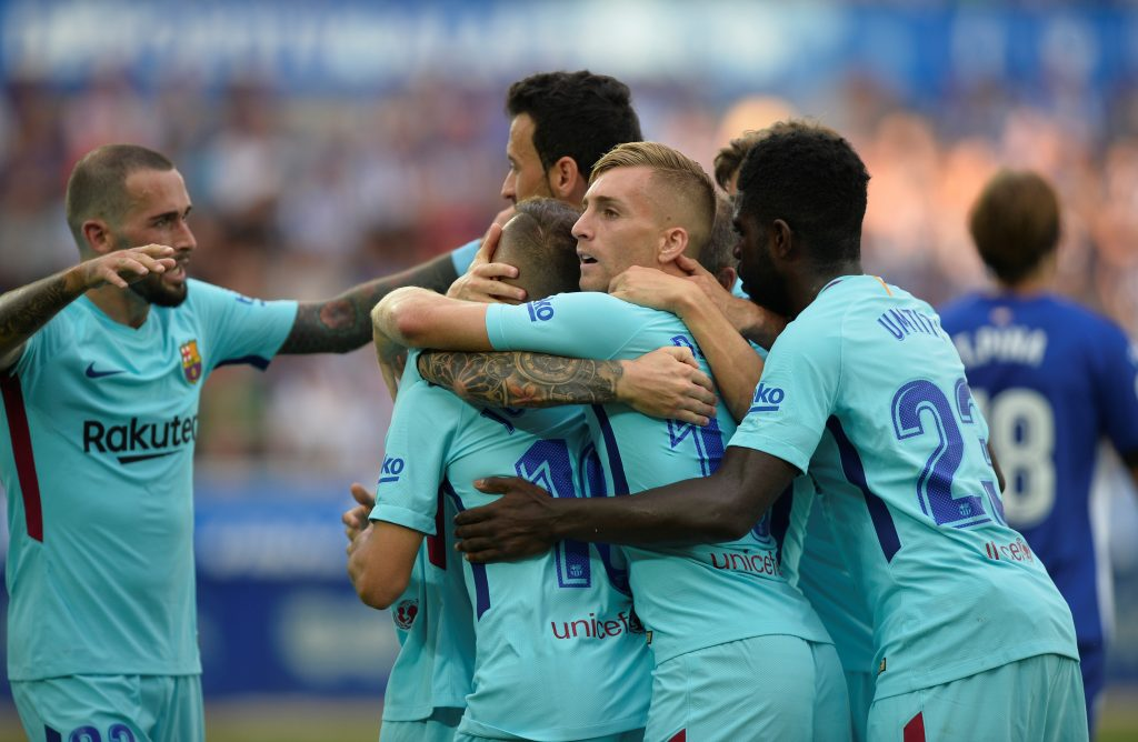 Barcelona's Lionel Messi celebrates scoring their first goal with Samuel Umtiti and team mates.
