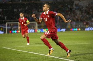Serbia's Mijat Gacinovic celebrates scoring their first goal.