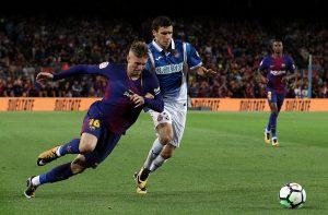 Barcelona's Gerard Deulofeu in action with Espanyol's Aaron Martin.