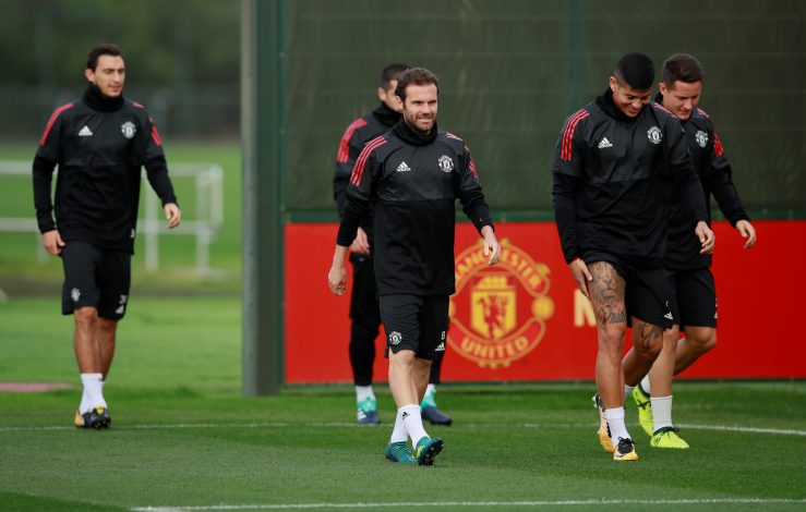 Juan Mata, Marcos Rojo and Ander Herrera during training.