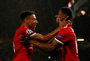 Marcus Rashford celebrates scoring goal with Jesse Lingard.