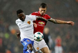 Victor Lindelof in action with Basel's Dimitri Oberlin.