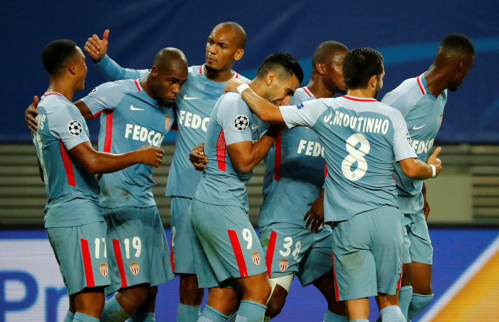 Monaco's Youri Tielemans celebrates scoring their first goal with teammates.