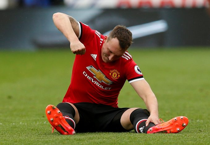 Phil Jones looks dejected after sustaining an injury.