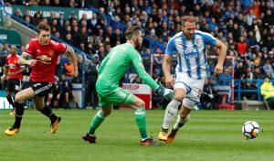 Huddersfield Town's Laurent Depoitre goes round David De Gea before scoring their second goal.
