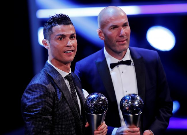 Cristiano Ronaldo celebrates after winning The Best FIFA Men's Player Award with Zinedine Zidane.