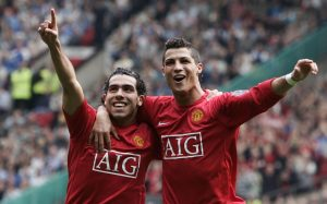 Carlos Tevez (L) celebrates with Cristiano Ronaldo after scoring against Wigan Athletic.