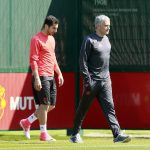 Jose Mourinho and Henrikh Mkhitaryan during training.