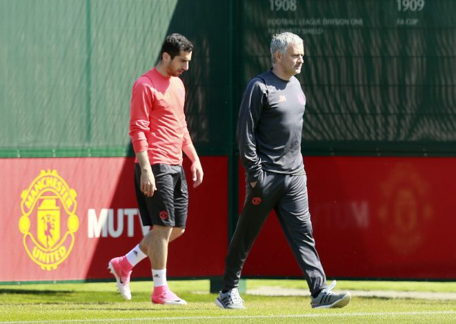 Jose Mourinho and Henrikh Mkhitaryan during training.