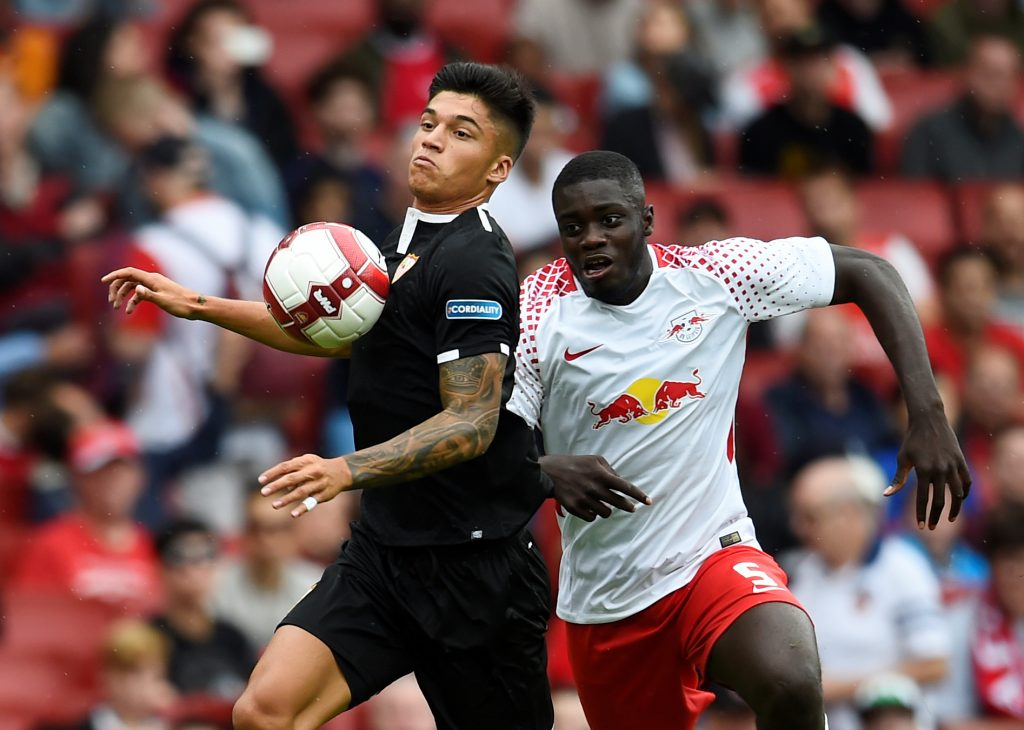Sevilla's Joaquin Correa in action with RB Leipzig's Dayot Upamecano.