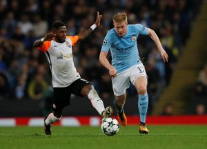 Manchester City's Kevin De Bruyne in action with Shakhtar Donetsk's Fred.