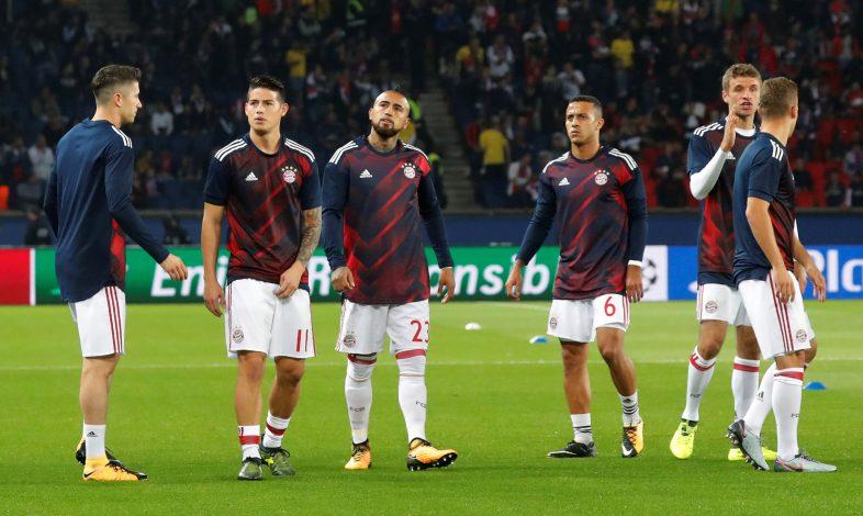 Bayern Munich's James Rodriguez, Thiago Alcantara, Thomas Muller and Arturo Vidal warm up.
