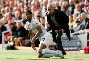 Jose Mourinho reacts as Marcus Rashford looks on.