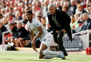 Jose Mourinho reacts as Marcus Rashford looks on.