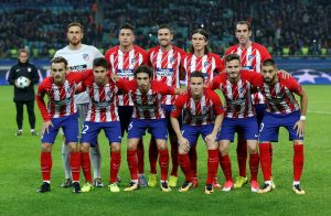 Atletico Madrid players pose for a team group photo before the match.