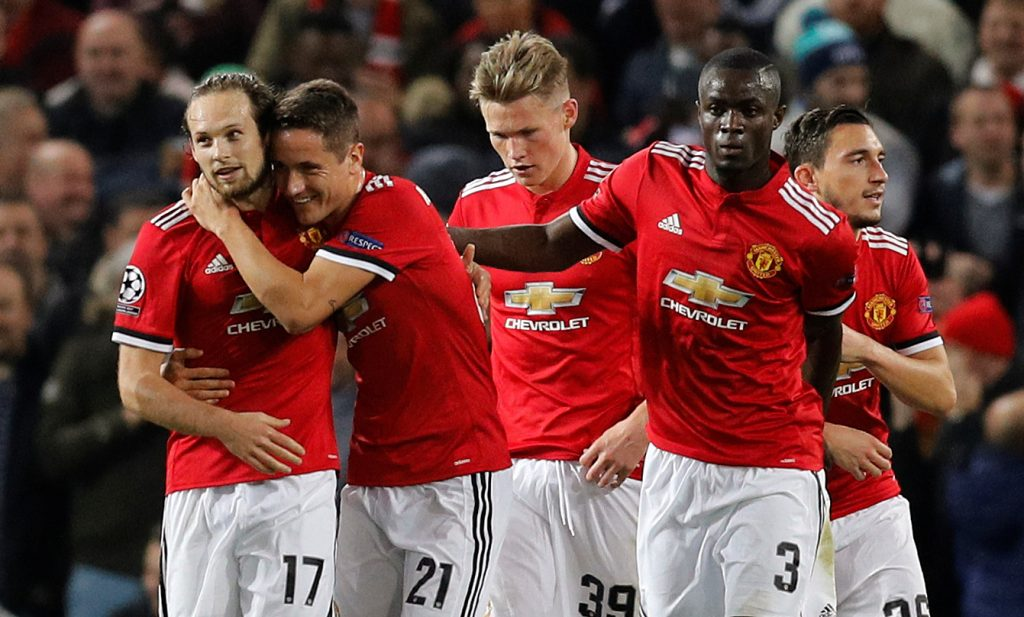 Daley Blind celebrates with Ander Herrera and Eric Bailly after scoring from the penalty spot.
