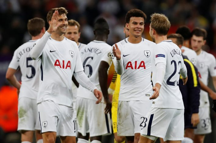 Tottenham's Dele Alli, Christian Eriksen and Fernando Llorente celebrate after the match.