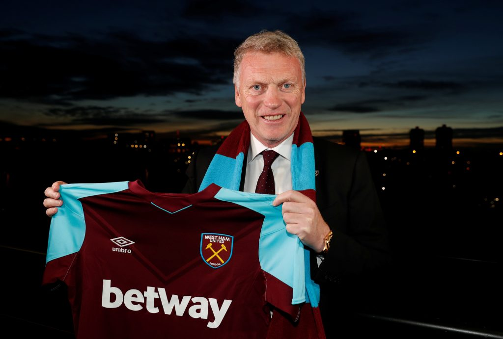 Soccer Football - West Ham United - David Moyes Press Conference - London Stadium, London, Britain - November 8, 2017   West Ham United manager David Moyes poses with the shirt after the press conference   Action Images via Reuters/John Sibley - RC111B9A2340