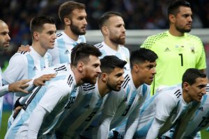 Argentina's Lionel Messi and Sergio Aguero line up with teammates before the match.