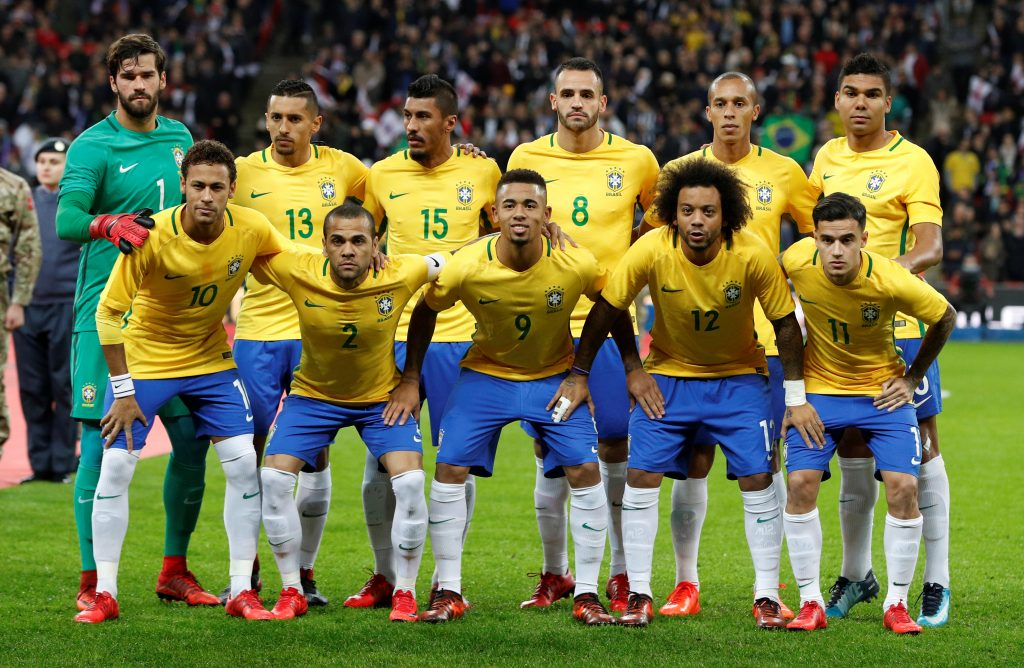 Brazil players pose for a team group photo before the match.