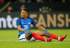 France's Anthony Martial reacts after going down.