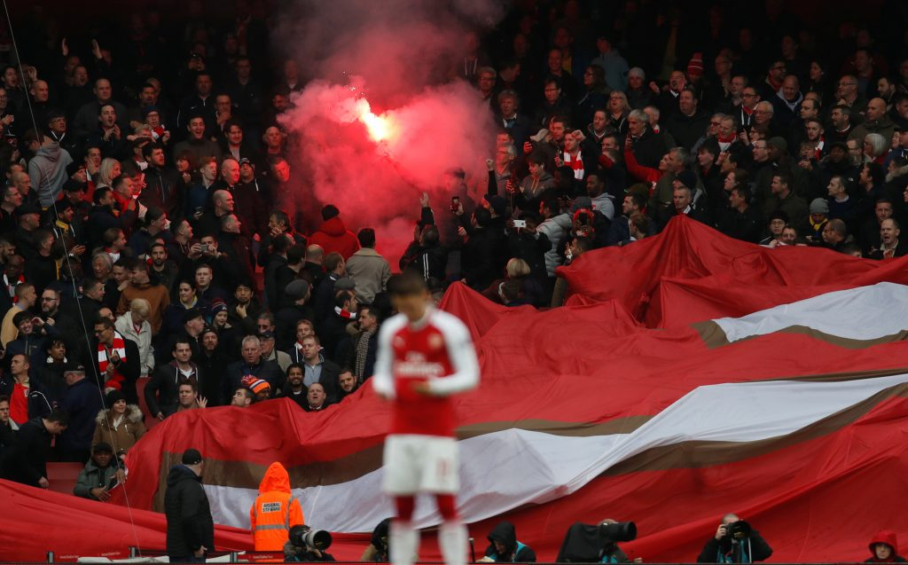 Arsenal fans with a flare.