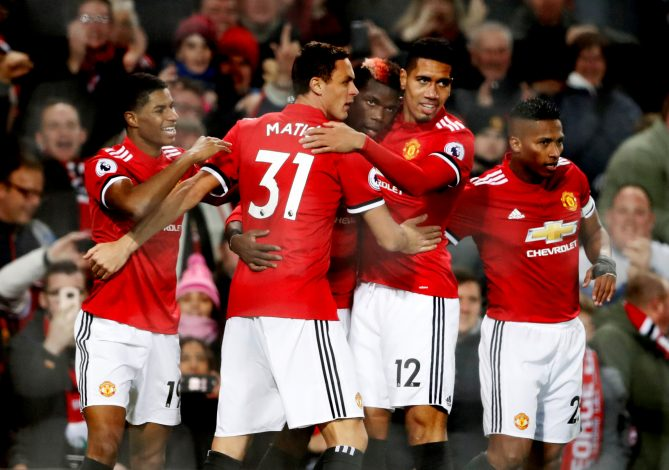 Paul Pogba celebrates with team mates.