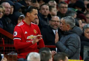 Zlatan Ibrahimovic prepares to come on as a substitute while he speaks to Jose Mourinho.