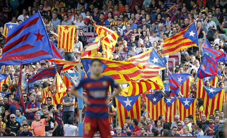 "Fans wave ""Estelada"" flags, a symbol of Catalonian pro-independence, during a Spanish first division soccer match."