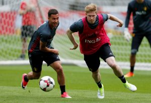 Belgium's players Eden Hazard and Kevin De Bruyne attend a training session.