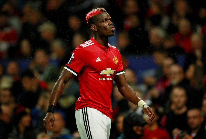 Paul Pogba walks off as he is substituted for Marouane Fellaini after sustaining an injury.