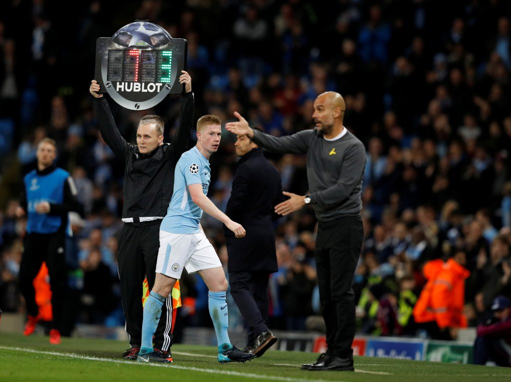 Man City's Kevin De Bruyne walks off to be substituted as manager Pep Guardiola looks on.