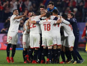 Sevilla's Guido Pizarro celebrates scoring their third goal with Sergio Escudero, Gabriel Mercado and team mates.