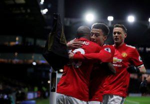 Ashley Young celebrates scoring goal with Jesse Lingard.
