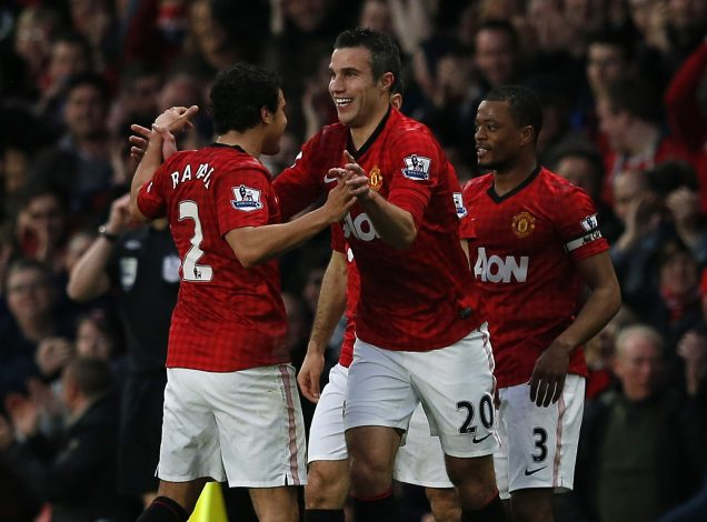 Manchester United's Robin Van Persie (C) celebrates his second goal against Aston Villa with Rafael (L) and Patrice Evra.