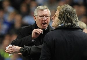 Alex Ferguson (L) gestures towards Roberto Mancini (R) during their soccer match at the Etihad stadium in Manchester, northern England April 30, 2012.