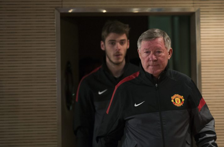 Sir Alex Ferguson (R) and David De Gea arrive at a news conference at Santiago Bernabeu Stadium.
