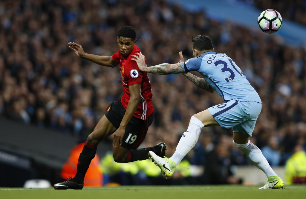 Nicolas Otamendi in action with Marcus Rashford.